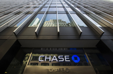 A sign is mounted on the side of a branch of the JPMorgan Chase & Co bank in New York