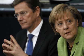 German Chancellor Merkel and Foreign Minister Westerwelle attend a debate on the euro rescue package in Berlin