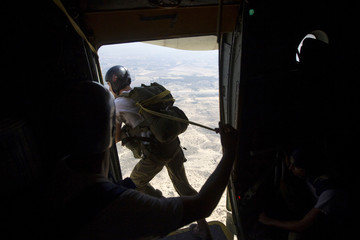 An Israeli army parachuting instructor jumps from an Israeli air force C-130 transport plane during a parachuting course near Tel Aviv