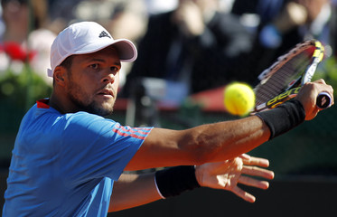 France's Tsonga plays a return to Argentina's Berlocq in their Davis Cup quarter-final tennis match in Buenos Aires