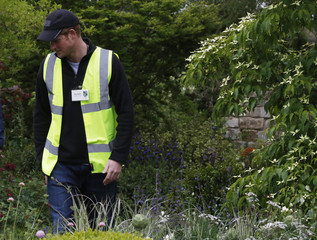 Britain's Prince Harry, walks through the M&G Centenary garden during a private unannounced visit to the Chelsea Flower Show in London
