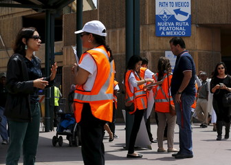 Immigration activists inform border crossing residents into the United States of their rights and encourage the reporting of any abuse they may see by federal officers in San Ysidro, California