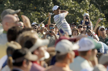 Tiger Woods of the U.S. hits from the 10th tee during a practice round for the 2010 Masters golf tournament at the Augusta National Golf Club