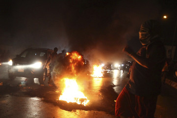 Relatives of Lebanese Shi'ite pilgrims that were abducted in Syria burn tires and block the main road leading to Beirut airport