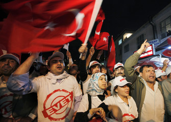 Supporters of Turkey's Prime Minister Recep Tayyip Erdogan wait in front of the Justice and Development Party building in Istanbul
