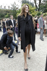 France's First Lady Carla Bruni-Sarkozy stands in the gardens of the Elysee Palace in Paris during 28th edition of National Heritage Days