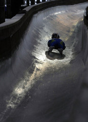 Halaydzhyan of Ukraine races down the ice track during first run of women's single Luge World Cup competition in Schoenau