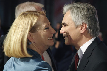 Faymann kisses Bures as he arrives for the bi-annual party conference in Vienna