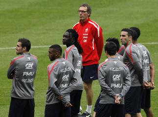 France's national soccer team coach Blanc talks to players during a training session in Paris