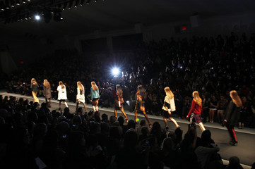 Models present creations from the Vivienne Tam Fall/Winter 2012 collection during New York Fashion Week
