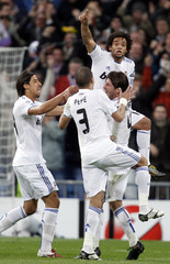 Real Madrid's Marcelo celebrates his goal against Olympique Lyon with teammates during Champions League soccer match in Madrid