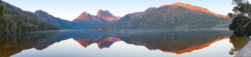 Acrylic Prints Reflection Beautiful panorama of mountain range reflected in lake on sunrise