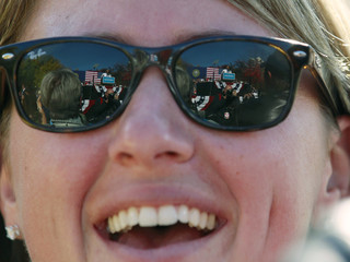 U.S. President Obama is reflected in the sunglasses of a supporter during a campaign rally at Veterans Memorial Park in Manchester