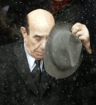 Nick Rizzuto Sr., dons his hat as he walks out of the church following his grandson Nick Rizzuto's funeral in Montreal
