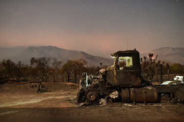 A burned out truck rests on a roadside after the Erskine Fire burned through Weldon