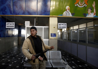 A rebel stands inside Benghazi's airport