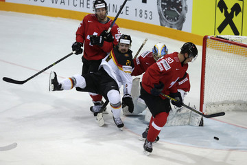 Germany's Krammer falls in front of Switzerland's goaltender Genoni during their Ice Hockey World Championship game at the O2 arena in Prague
