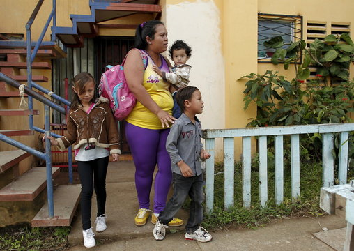 Hazel Castillo leaves her home with her three children to an aerobics class in Los Guidos de Desamparados