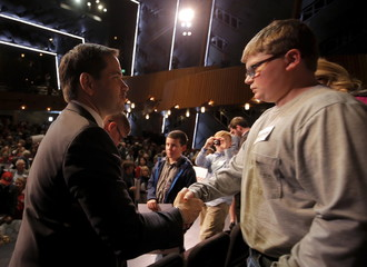 U.S. Republican presidential candidate Marco Rubio shakes hands with a young boy during a campaign town hall at Francis Marion University in Florence