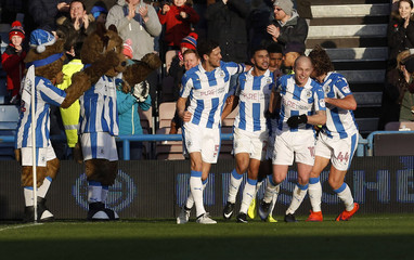 Huddersfield Town's Nahki Wells celebrates scoring their first goal with team mates