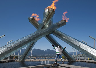 Vancouver Canucks mascot Fin stands in front of the 2010 Olympic Cauldron in support of the team during the NHL Stanley Cup Final in Vancouver