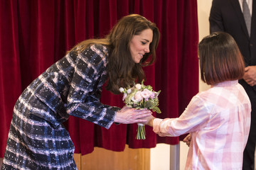 Britain's Catherine, Duchess of Cambridge recieves a posy of flowers at Francis House during a visit to the hospice in Manchester
