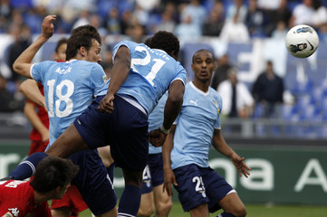 Lazio's Diakite  jumps for the ball and scores against Cagliari during their Italian Serie A soccer match in Rome