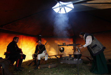 History enthusiasts prepare in a tent before the re-enactment of Napoleon's famous battle of Austerlitz near the town of Slavkov