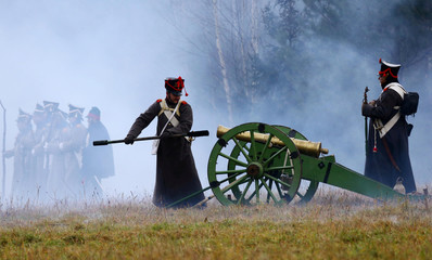 People dressed in the historic uniforms of the Imperial Russian army take part in a re-enactment of the 1812 Battle of Berezina, to mark the 204th anniversary of the battle, near the village of Bryli