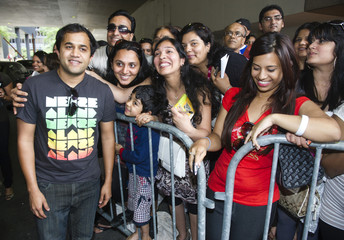 Bollywood actor Vaidya poses with fans in Toronto