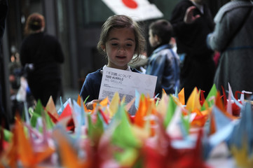 A child looks at paper cranes during a origami session called Senbazuru in favour of disaster victims in Japan in the Ahondiga cultural centre in Bilbao.