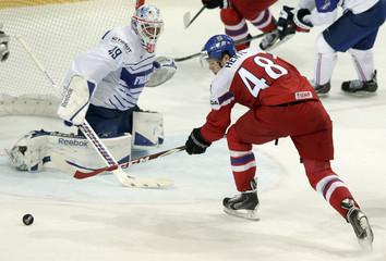 Hertl of the Czech Republic fails to score against France's goaltender Hardy during their Ice Hockey World Championship game in Prague
