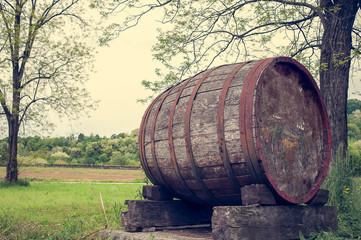 Old wooden barrel. Photo in vintage style.