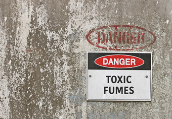 red, black and white Danger, Toxic Fumes warning sign