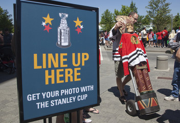 Jerry Ruck gets in line with his Cigar Store statue to his picture taken with the NHL's Stanley Cup in Surrey