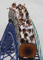 Japanese women in kimonos ride a roller-coaster as they celebrate Coming of Age Day at Toshimaen amusement park in Tokyo