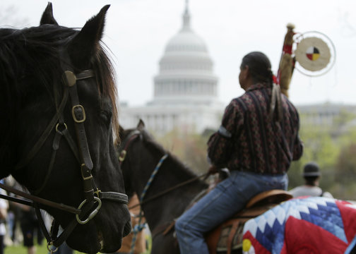 Matthew Black Eagle Man protests in front of the U.S. Capitol with the Cowboys and Indian Alliance against the Keystone XL pipeline in Washington