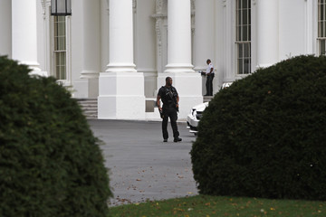Secret Service agents in uniform lock down the North Lawn and entrances to the White House in Washington