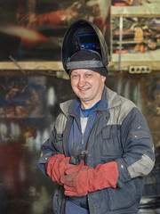 The smile of a welder.