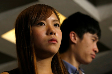 Pro-independence activists Yau Wai-ching and Baggio Leung meets journalists outside the High Court in Hong Kong
