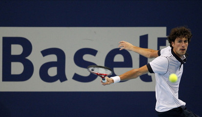Dutch Haase returns the ball to Switzerland's Chiudinelli at the Swiss Indoors ATP tennis tournament in Basel