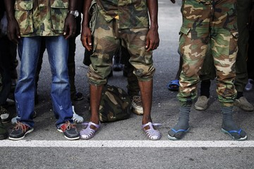 Footwear worn by new recruits from the Republican Forces of Ivory Coast (FRCI) are seen as they gather at a base in Abidjan