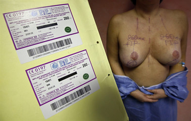 ID cards with serial numbers of silicone gel breast implants, manufactured by French company Poly Implant Prothese, which will be removed from the patient in a clinic in Nice