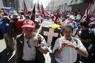Union members carry a symbolic coffin during a protest in Guatemala City