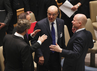 British Foreign Secretary Hague laughs with UN Secretary-General Ban, and French Foreign Minister Alain Juppe at UN Headquarters in New York