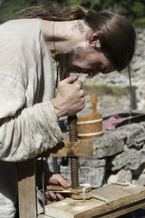 Man demonstrates medieval craftsmen skills during the annual Medieval Day in Cesis castle