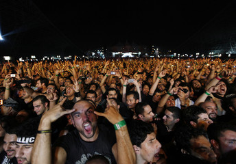 Fans in the crowd react during heavy metal band Metallica's World Magnetic tour concert in Abu Dhabi