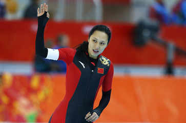 China's Zhang Hong waves during the women's 1,000 metres speed skating race at the Adler Arena during the 2014 Sochi Winter Olympics