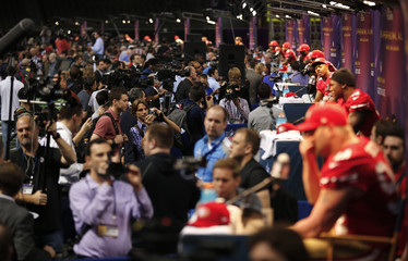 San Francisco 49ers players are interviewed by journalists during Media Day for the NFL's Super Bowl XLVII in New Orleans