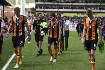 Hull City's Evandro Goebel and team mates look dejected after the match